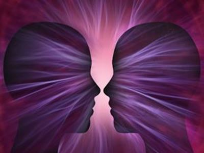 Silhouette of two heads facing each other