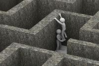 person being lifted out of a maze by another person