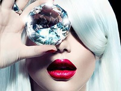 women with white hair looking through a large diamond