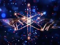 two hands touching an atom