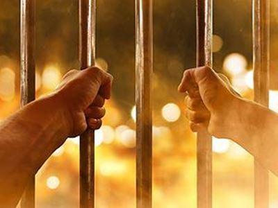 Hands on jail bars